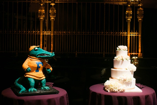 Bride's cake with white frosting and flowers and Florida Gators groom's cake Albert the Alligator