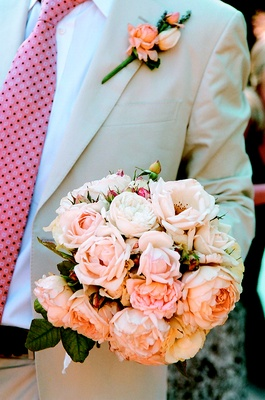 Groom Holds White And Pink Peony Wedding Bouquet