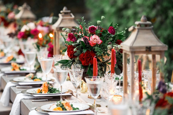 fall wedding, king's table with wooden lanterns, red tapered candles, burgundy roses