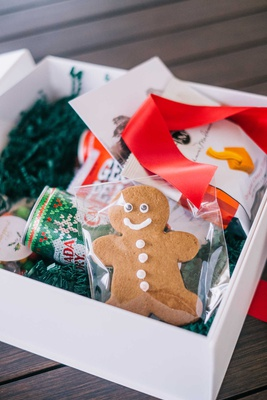 wedding welcome box holiday theme red ribbon christmas canada dry gingerbread man cookie