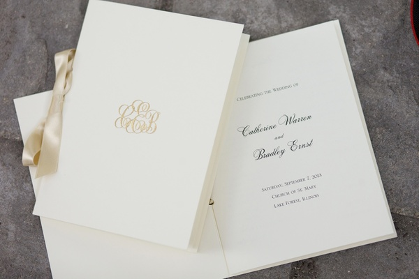 Wedding ceremony program with gold monogram