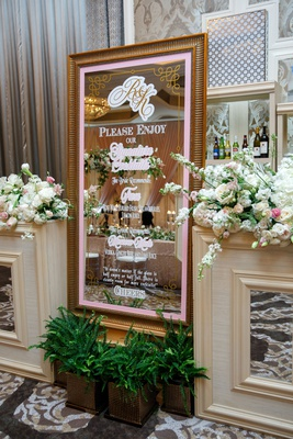 wedding reception signature cocktail menu frose moscow mule quote gold frame mirror flowers