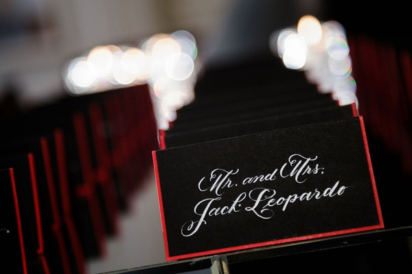 elizabeth grace chicago wedding escort cards black stationery red border white calligraphy