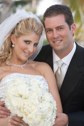 Bridal attire and men's tuxedo