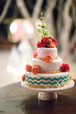 colorful three tier wedding cake florals wave patterns gold blue orange red green mexico destination