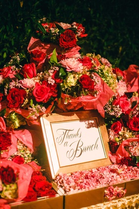 "Red rose, pink flower, red flower bouquets for wedding favors with ""Thanks a Bunch"" sign"