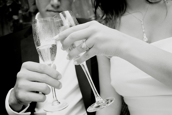bride and groom toast champagne, christopher designs engagement ring