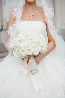 White wedding bouquet with rose, ranunculus, and peony flowers