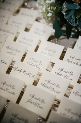 Wedding reception sparkle linen sequin with calligraphy on escort cards traditional