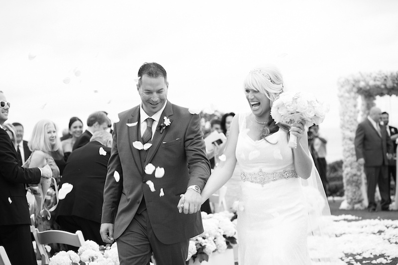 Black and white photo of bride and groom recessional
