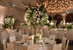 Ballroom wedding reception round table mirror with high centerpiece white flower greenery candles