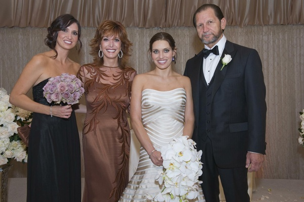 Bride in a strapless Vera Wang gown with family