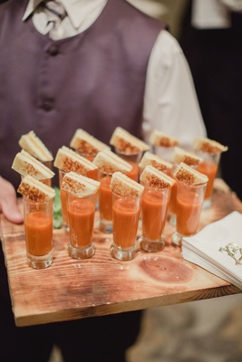 Wedding reception cocktail hour with tomato soup in shot glasses grilled cheese