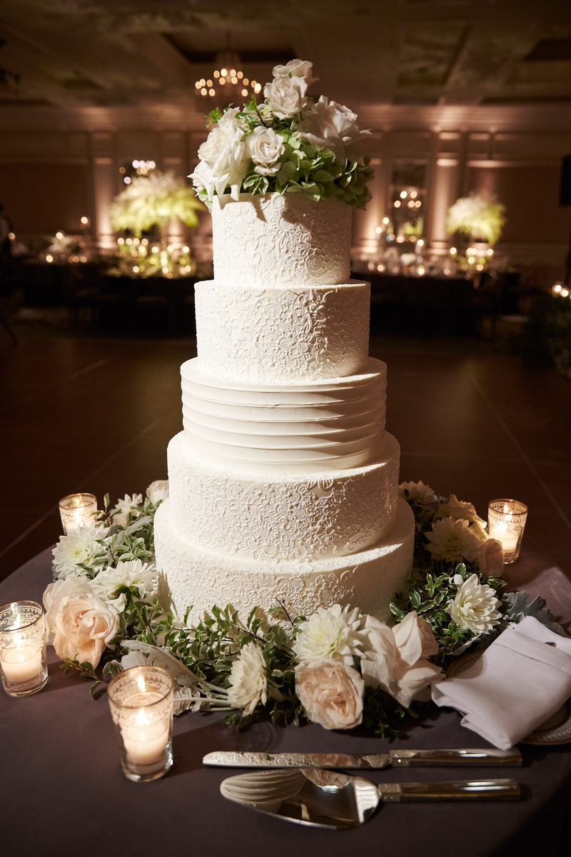 Wedding Cake With Design Of Brideu0027s Dress And Fresh Flowers At Top And Base Gluten  Free