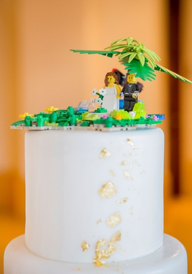 white wedding cake gold foil details lego cake topper tropical palm tree design made by son of bride