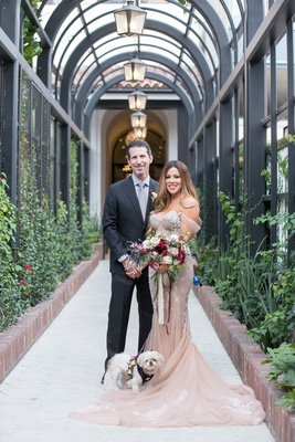bride in inbal dror wedding dress fall bouquet lilla bello with groom and white dog with flowers