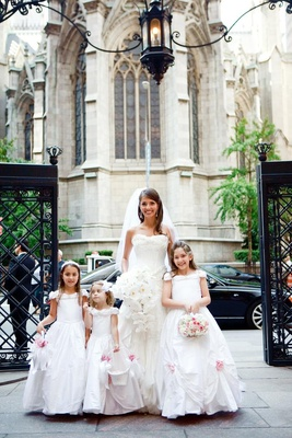 Ivory bridal gown and white flower girl dresses
