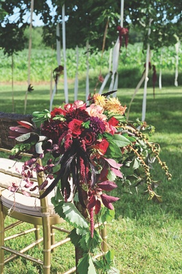 Aisle marker on outdoor ceremony chair