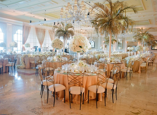 Wedding reception ballroom the breakers round tables white flower centerpiece palm tree chandeliers