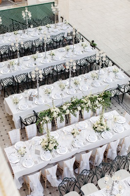 view from above outdoor wedding reception on long banquet tables