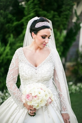 Bride wearing beaded bodice wedding dress with long sleeves