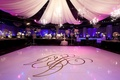 Purple dance floor with chandeliers