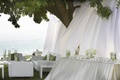 White drapery over seating card table and lounge