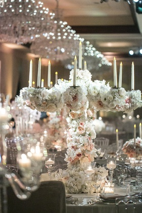 fake candles, candelabra covered with white and blush roses