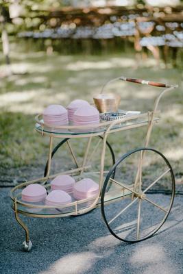 wedding ceremony outdoor vintage cart bar cart with pink yarmulke jewish wedding ceremony