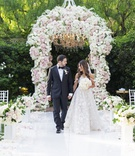 bride in galia lahav wedding dress groom in tux white pink flower chuppah beverly hills hotel