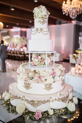 wedding cake with gold details fresh and sugar flowers scallop details pretty table royal monogram