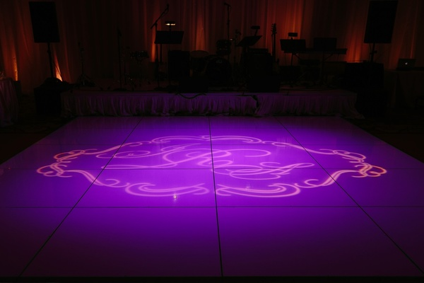 purple lighting, monogram on dance floor
