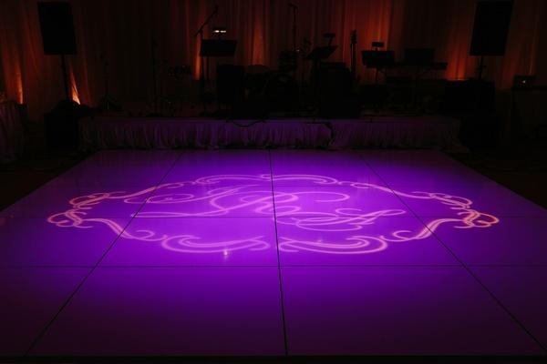 purple lighting, monogram on dance floor