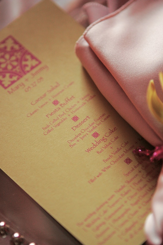 Golden menu card with pink writing