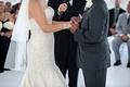 Bride wearing crystal bracelet next to groom at ceremony