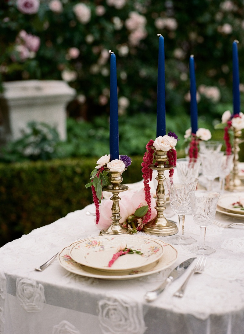 Wedding reception destination wedding elopement bright blue navy taper candle gold candlesticks