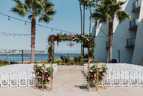 long beach wedding, ceremony arch between two palm trees, fall wedding color scheme