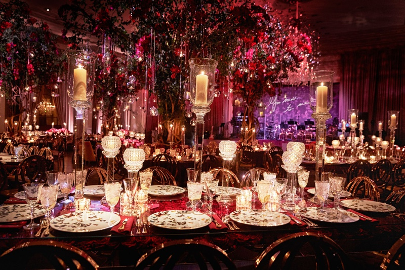 opulent wedding reception ballroom purple neon sign red lighting decor butterfly china candles