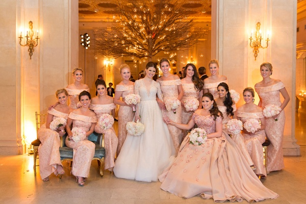 Bride in Reem Acra wedding dress with off shoulder blush dress with matron of honor applique dress