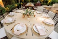 wedding reception round table gold charger plate small short centerpiece pink ivory greenery flowers