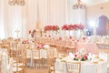 wedding reception ballroom white drapery gold chairs centerpieces hot pink light pink flowers