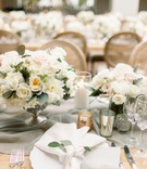 wedding reception long wood table linen runner white garden rose eucalyptus centerpiece candles