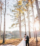bride in mock turtleneck wedding dress cathedral veil groom in forest sun fall winter trees lake