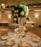centerpiece with greenery, soft blush roses, hydrangeas, wide, tall vase, gold chargers