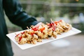 cauliflower and roasted red bell pepper kebabs at tapas bar tray passed appetizer wedding ideas