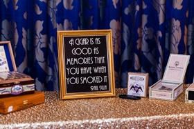 Cigar tent at gold, blue, and white wedding with frame quote