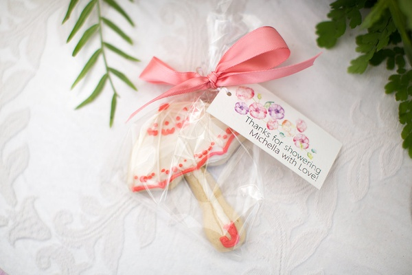 outdoor wedding shower with frosted parasol cookie favors flowery label of thanks pink ribbon