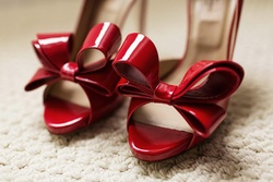 Red patent-leather Valentino pumps with bows