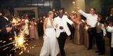 Bride in halter dress and groom's sparkler wedding exit