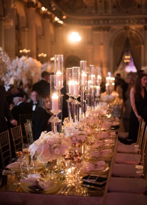 wedding reception long rectangle table mirror top low flower centerpiece tall candles candlelight